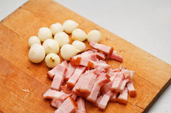 Ham and onions. Prepared ham and onions for cooking on a wooden board Stock Photography