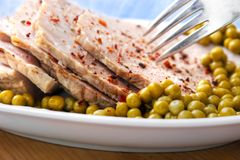 Ham with peas Stock Images