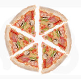 Ham, and pepper pizza slices. A whole ham with mushrooms and colorful pepper pizza slices ready for eating, isolated on a white background royalty free stock photography