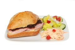Ham and pickle roll with salad. And coleslaw on a plate isolated against white Royalty Free Stock Photos
