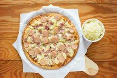 Ham and pineapple hawaiian pizza Stock Photos