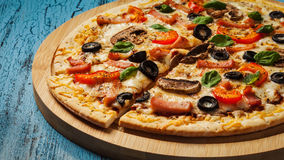 Ham pizza on blue wooden background Royalty Free Stock Photography