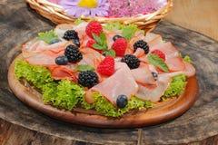 Ham plate, ham, fruit, raspberries, blueberries, blackberries, l Royalty Free Stock Images