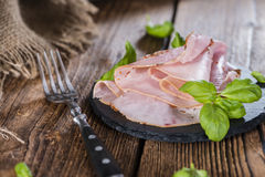 Ham. Portion of Ham with fresh herbs (close-up shot royalty free stock photos