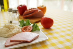 Ham and potatoes Stock Images