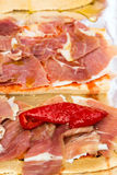 Ham with red pepper. Royalty Free Stock Photo