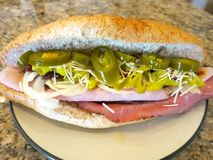 Ham and Roast Beef Sandwich. A ham and roast beef sandwich with jalapeno peppers, onions, parmesan cheese, and more Stock Photo