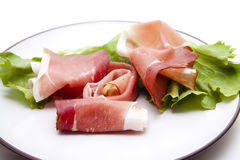 Ham rolled with salad leaf Stock Images