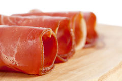 Ham rolled in a wooden board Royalty Free Stock Photo