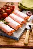 Ham rolls. On wooden cutting board Stock Images