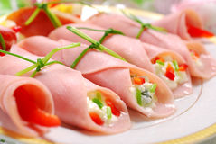 Ham rolls stuffed with cheese and vegetables Royalty Free Stock Image