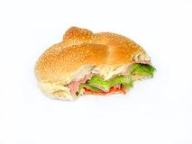 Ham salad roll bitten. Ham salad roll royalty free stock photos