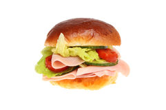 Ham salad roll. Ham and salad in a brioche roll  against white Royalty Free Stock Photos