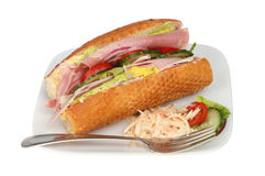 Ham salad roll on a plate Stock Images