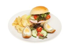 Ham salad roll and garnish Royalty Free Stock Image