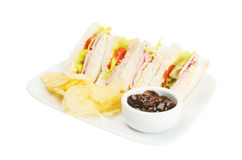 Ham salad sandwich. With crisps and pickle on a plate Stock Images