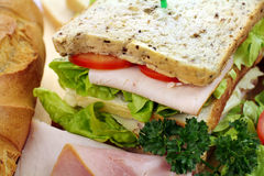 Ham And Salad Sandwich. Delicious ham and salad sandwich with ingredients ready to serve Royalty Free Stock Photography