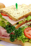 Ham And Salad Sandwich. Delicious ham and salad sandwich with ingredients ready to serve Royalty Free Stock Image