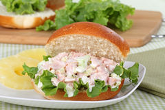 Ham Salad Sandwich. Ham salad with lettuce on a bun and pineapple slices Royalty Free Stock Photography