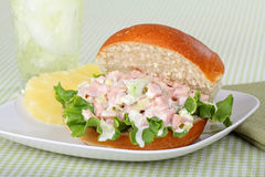 Ham Salad Sandwich. Ham salad with lettuce on a bun and a drink Royalty Free Stock Photography