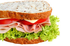 Ham and Salad Sandwich. On wholewheat bread.  With curly lettuce, tomatoes and cheese Royalty Free Stock Image