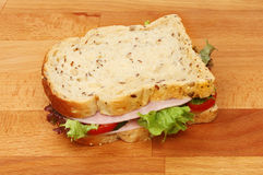 Ham salad sandwich on a chopping board Royalty Free Stock Image