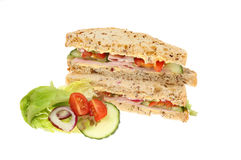 Ham salad sandwich with garnish. Ham salad sandwich made with seeded bread with salad garnish isolated against white Royalty Free Stock Photo