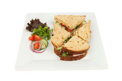 Ham salad sandwich. With salad garnish on a square plate isolated against white Stock Images
