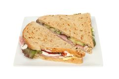 Ham salad sandwich. Made with granary bread on a plate isolated against white royalty free stock photography