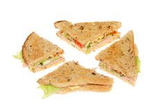 Ham salad sandwich. Made with lightly toasted granary bread cut into quarters isolated against white Royalty Free Stock Photography