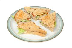 Ham salad sandwich. Made with lightly toasted granary bread on a plate isolated against white Royalty Free Stock Photo