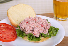 Ham Salad Sandwich. Ham salad and lettuce on a bun with sliced tomatoes on the side Stock Images