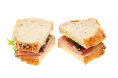 Ham salad sandwich. Made with crusty seeded bread isolated against white Royalty Free Stock Photo