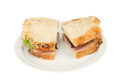 Ham salad sandwich. Made with rustic bread on a plate isolated against white Stock Image