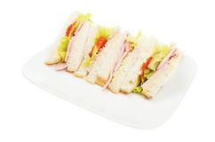 Ham salad sandwich on a plate. Isolated against white Stock Images