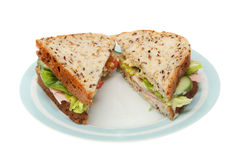 Ham salad sandwich. In soya and linseed bread on a plate isolated against white Royalty Free Stock Photos