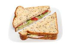 Ham salad sandwich. In soya and linseed bread on a plate isolated against white Stock Images
