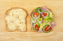 Ham salad sandwich. Two halves of a ham salad sandwich on a wooden board Royalty Free Stock Photography