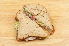 Ham salad sandwich. Wholegrain bread ham salad sandwich on a wooden board Stock Image