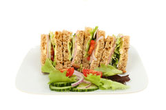 Ham salad sandwich. With wholemeal bread with garnish on a plate isolated against white Royalty Free Stock Photography