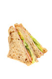 Ham and salad sanwich. Ham and salad sandwiches made with brown bread isolated against white royalty free stock photos