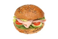 Ham salad seeded roll. Ham salad in a seeded wholemeal bread roll isolated against white Stock Image