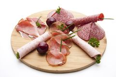 Ham with salami and cherries Stock Photo