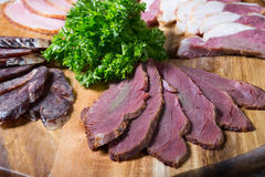 Ham, salami, meat. Different sorts of parma ham meat on wooden tray Royalty Free Stock Image