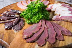 Ham, salami, meat. Different sorts of parma ham meat on wooden tray Stock Photos