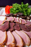 Ham, salami, meat. Different sorts of parma ham meat on wooden tray Royalty Free Stock Photos