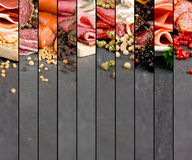 Ham and Salami Mix. Photo of ham and salami mix with herbs and pepper spice on gray slate surface stock images