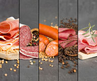 Ham and Salami Mix. Photo of ham and salami mix with herbs and pepper spice on gray slate surface royalty free stock photography