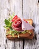 Ham and salami on toast Stock Images