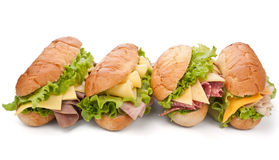 Ham, salami, turkey and beef sandwiches Stock Photos